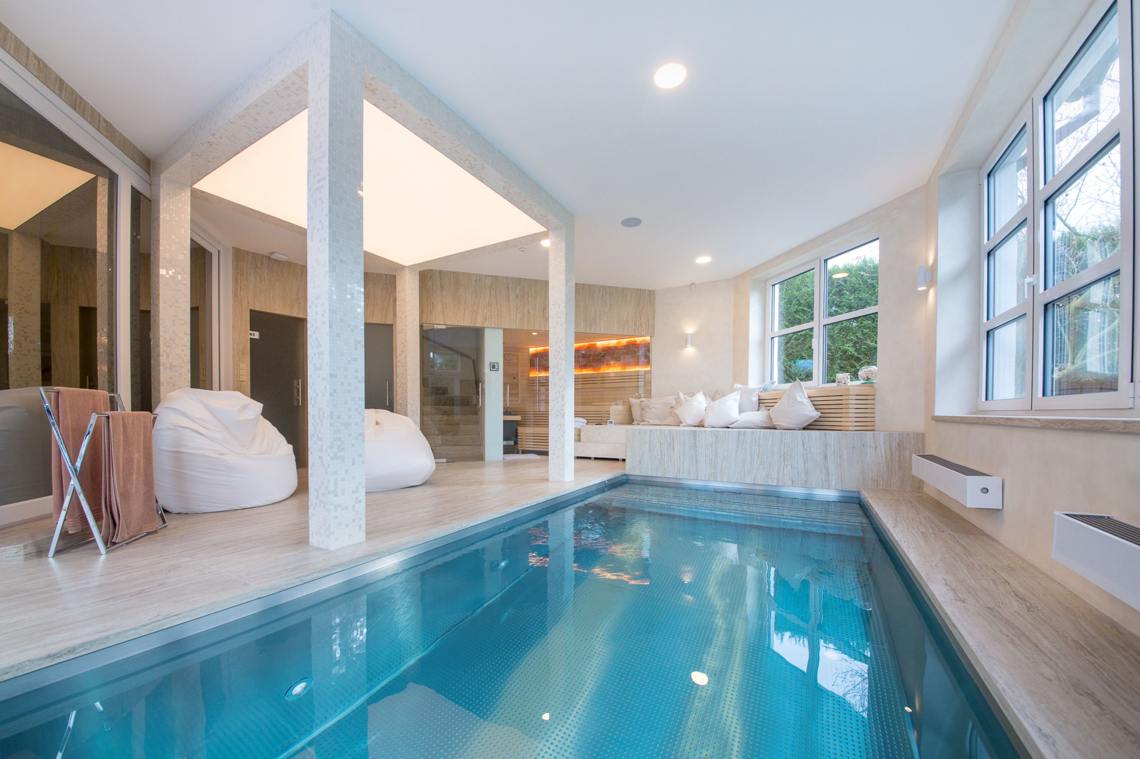 Atypically shaped indoor pool with massage bench