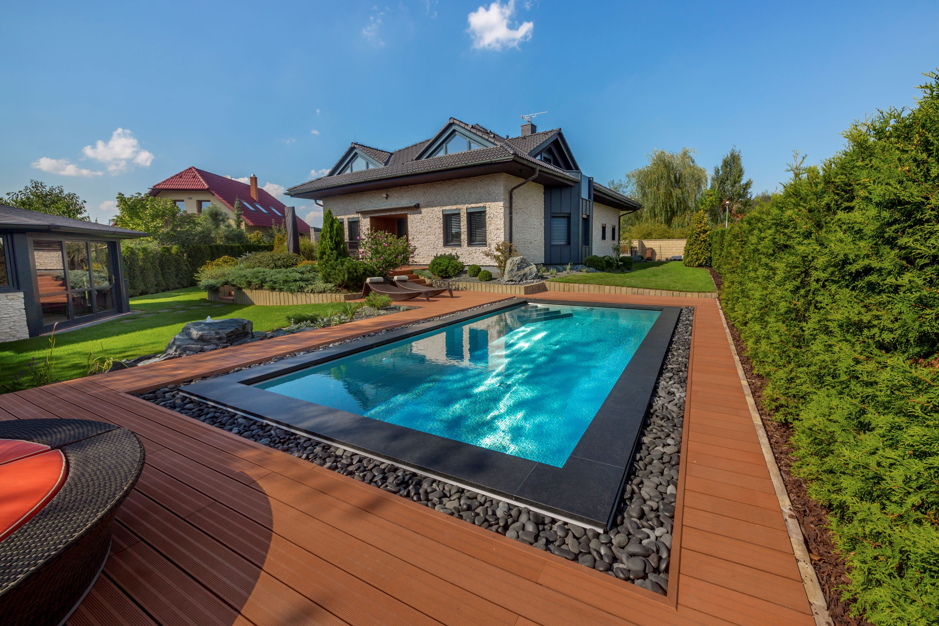 Stainless-steel pool with pebble overflow